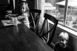 young boy and girl at kitchen table