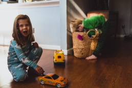 young girl and boy play in living room